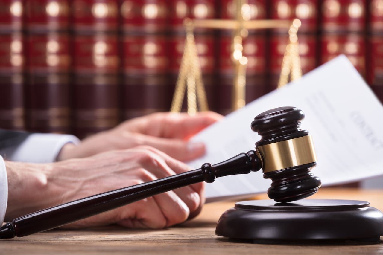 judge reading court evidence
